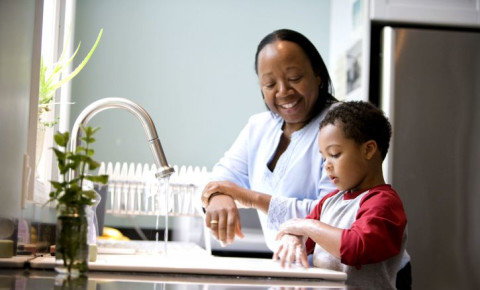 black-child-mother-parent-cleaning-kitchen-home-kids-familyjpg
