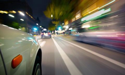 Car on road speeding blurred motion 123rf