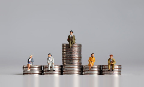 economic-inequality-people-sitting-on-stacks-of-coinsjpg