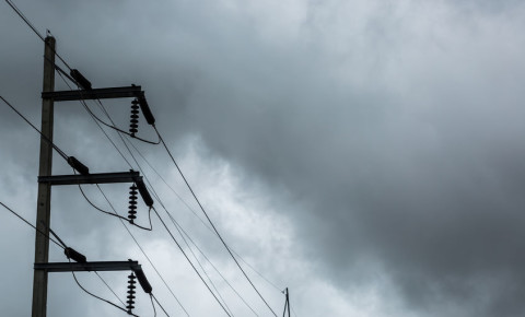 Electricity pole high voltage power lines cloudy overcast sky rain weather 123rf
