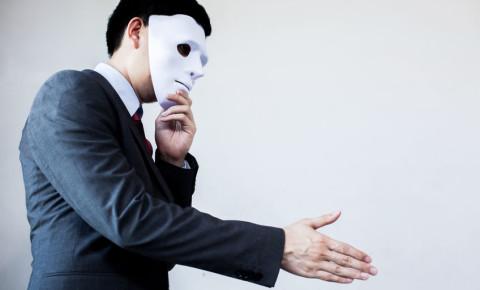 Fraud fraudster scam scamster artist mask corruption 123rf