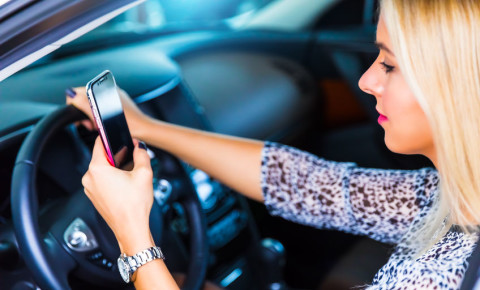 Using mobile cell phone while driving 123rf