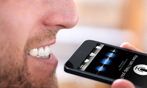 man-using-voice-recognition-on-mobile-phonejpg