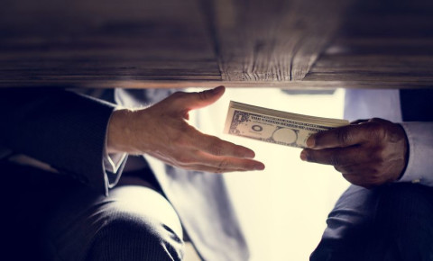 Corruption money bribes 123rf