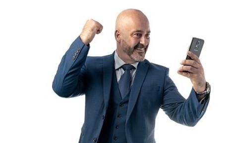 smiling-businessman-looking-at-phonejpg