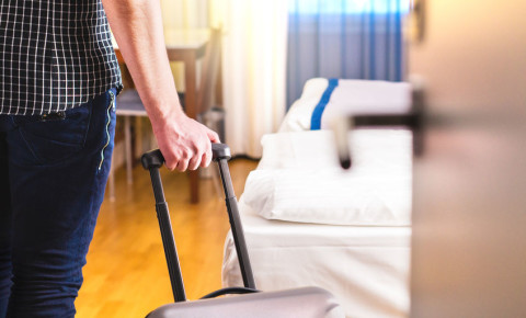 man-suitcase-travel-tourism-hotel-bed-room-accommodation-stay-getaway-123rf
