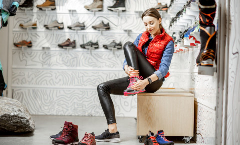 Woman trying on sports shoes 123rf