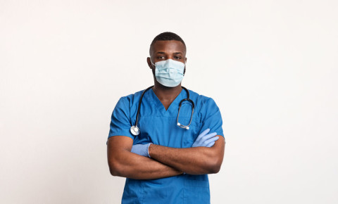 black-doctor-mask-gloves-PPE-covid-19-coronavirus-healthcare-worker-123rf
