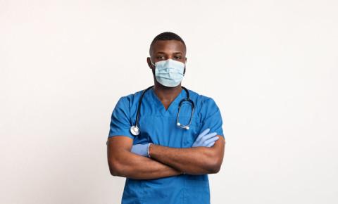 black-doctor-mask-gloves-PPE-covid-19-coronavirus-healthcare-worker-123rf