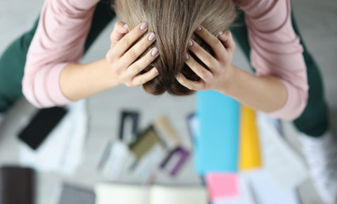 consumer-stressed-woman-bent-over-bank-cards-budgetjpg