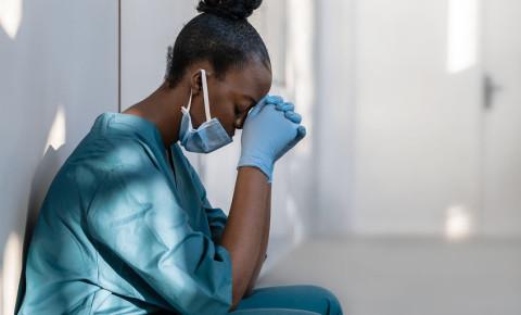 Tired depressed anxious stressed female nurse mask healthcare frontline 123rf
