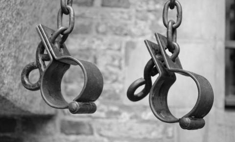 Shackles as symbol of slavery 123rf
