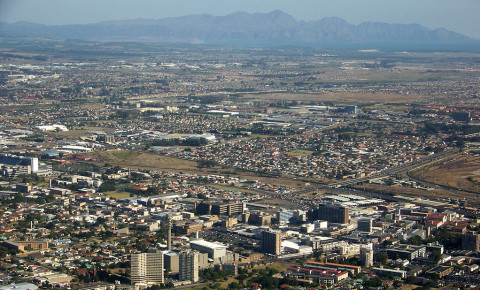 Bellville CBD aerial, with Kogelberg Mountains and False Bay in the background