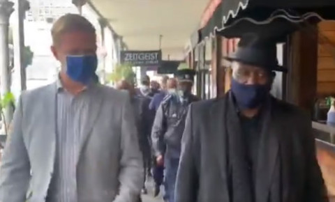 JP Smith and Minister Bheki Cele walk down Long Street Cape Town