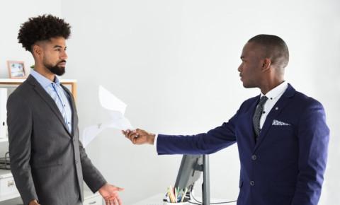 manager-employer-handing-document-to-employeejpg