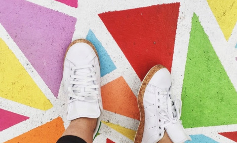 White sneakers on colourful floor