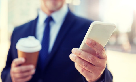 man-in-suit-with-smartphone-and-takeaway-coffeejpg