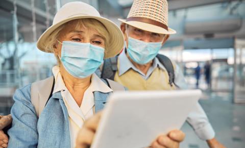 travel tourism tourist elderly couple tablet technology airport 123rf