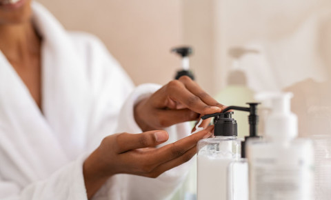 skincare black woman bath robe gown pampering spa cosmetic liquid soap bathroom