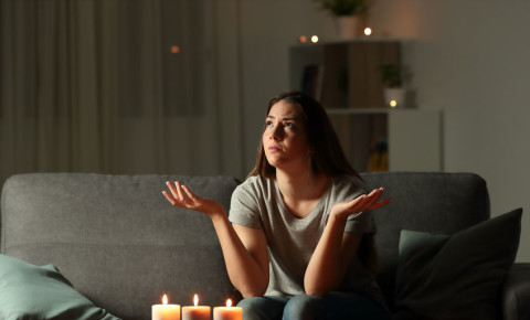 load-shedding-black-out-power-cut-outage-candles-woman-darkness-lights-out-123rf
