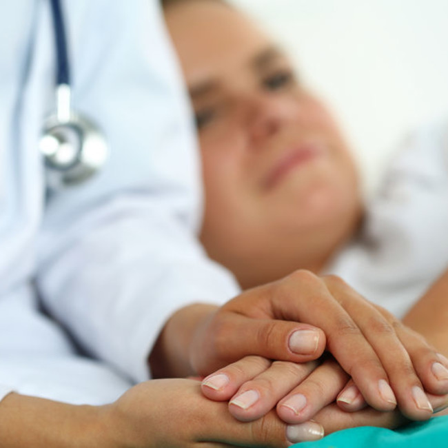 Female doctor holds patient hand medical 123rflifestyle 123rf