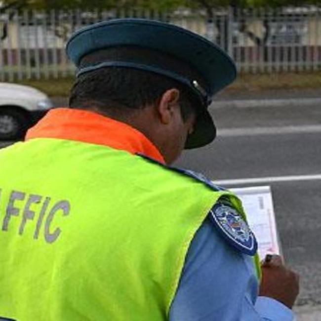 traffic cop issues fine ewn