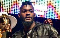 In this file photo taken on 2 October 2017 Ivory Coast's musician DJ Arafat holds the award for best artist of the year during the Coupe-Decale Awards in Abidjan. Picture: AFP