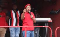 Economic Freedom Fighters (EFF) leader Julius Malema addresses supporters outside the building where state capture commission has been hearing evidence from Minister Pravin Gordhan on 20 November 2018. Picture: Abigail Javier/EWN.