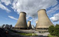 FILE: A view of the cooling towers of the Drax coal-fired power station near Selby, northern England on 25 September 2015. Picture: AFP
