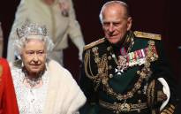 Queen Elizabeth II and Prince Philip at the Palace of Westminster after the state opening of Parliament on 8 May 2013 in London. Picture: AFP.