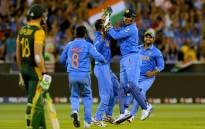 FILE: India's captain Mahendra Singh Dhoni (2nd R) celebrates with teammates after running out South Africia's AB de Villiers on February 22, 2015. Picture: AFP