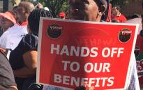 FILE: A demonstrator holds a sign outside Sars headquarters in Pretoria during a protest for 11% salary increase. Picture: Robinson Nqola/EWN