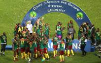 FILE: Cameroon's players celebrate with the trophy at the end of the 2017 Africa Cup of Nations final football match between Egypt and Cameroon at the Stade de l'Amitie Sino-Gabonaise in Libreville on 5 February 2017. Picture: AFP