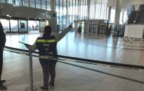 An official pictured on scene at the Cape Town International Airport where one person was wounded during a shooting, on 18 October 2017. Picture: Lauren Isaacs/EWN