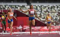 USA's Sydney Mclaughlin (C) wins the women's 400m hurdles final setting a new world record during the Tokyo 2020 Olympic Games at the Olympic Stadium in Tokyo on 4 August 2021. Picture: Jewel Samad/AFP