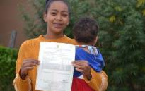 Tashreeqa Isaacs from Rosedale in Kariega (Uitenhage), pictured with her child, has not been able to get an identity document or register her baby because she has the same name and date of birth as someone else. Picture: Thamsanqa Mbovane/GroundUp