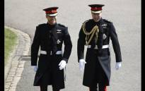 FILE: Britain's Prince Harry (L), Duke of Sussex, arrives with his best man Prince William, Duke of Cambridge (R), at St George's Chapel, Windsor Castle, in Windsor, on May 19, 2018 for his wedding ceremony to marry US actress Meghan Markle. Picture: AFP.