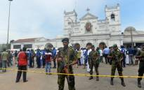 FILE: Sri Lankan security personnel keep watch outside the church premises following a blast at the St. Anthony's Shrine in Kochchikade, Colombo on 21 April 2019. Picture: AFP