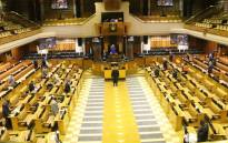 Some members of Parliament in the House while others connect virtually on 23 June 2020. Picture: GCIS.