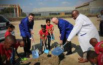 Stefan Huelsenberg(Rosslyn plant Director) Tim Abbott(CEO BMW South Africa) Mzwandile Masina(Deptuty Minister DTI) soil turning ceremony at landmark of new plant to be constructed.Picture : Kgothatso Mogale/EWN