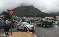 Traffic officials towed taxis used to barricade the main road leading into Imizamo Yethu in Hout Bay. Picture: Petrus Botha/EWN