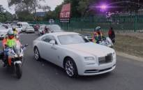 Police escort Pastor Alph Lukau to church. Picture: Twitter.