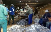 Farmers belonging to the Lesotho Wool and Mohair Association at a factory. Picture: Supplied.