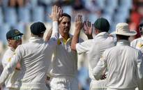 FILE: Australia cricketer Mitchell Johnson celebrates with team-mates after taking the wicket of South Africa's Ryan McLaren, during the fourth day of the first Test match between South Africa and Australia at SuperSport Park in Centurion on 15 February 2014. Picture: AFP