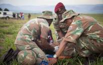 FILE: Shot by illegal immigrants, a member of the SANDF plays wounded during an exercise on the SA/Swazi border. Picture: Thomas Holder/EWN