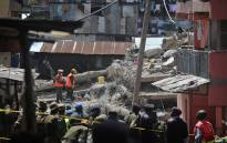 Rescuers search for bodies trapped in rubble on 2 May 2016 at the scene of a collapsed residential building in the low-income suburb of Huruma in Nairobi. The death toll in the collapse of a six-storey building in Nairobi on 29 April rose to 21 on 2 May. Picture: AFP