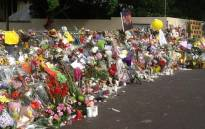 Tributes continue to flow outside the home of former president Nelson Mandela in Houghton. Picture: Gia Nicolaides/EWN.