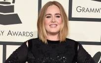 FILE: Singer Adele on the red carpet during the 58th Annual Grammy Music Awards in Los Angeles in February 2016. Picture: AFP.