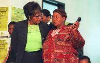 Winnie Madikizela-Mandela (left) with Joyce Seipei, mother of murdered child activist Stompie Seipei, at the Truth and Reconciliation Commission (TRC) hearings in Johannesburg on 4 December 1997. Picture: AFP.