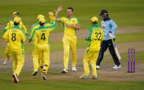 Australia's Josh Hazlewood (C) celebrates the dismissal of England's Jason Roy (R) for three runs during the one-day international (ODI) cricket match between England and Australia at Old Trafford in Manchester on 11 September 2020. Picture: AFP